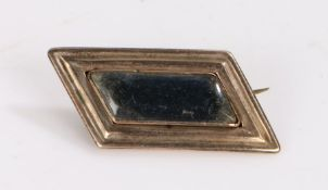 19th Century brooch, the yellow metal angled frame with a central glazed locket panel, 32mm wide