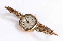Yellow metal ladys wristwatch, with Arabic numerals set on a silvered dial