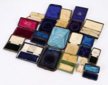 Collection of antique leather clad jewellery boxes some named (Qty)