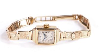 9 carat gold ladies wristwatch, having square silvered dial with arabic numerals, 15mm wide, total