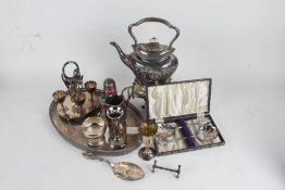 Silver plated wares to include tray, kettle and stand with burner, egg cruet, sugar castor, trophy
