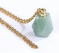 Jade pendant on a yellow metal chain