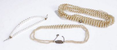 Three pearl necklaces one with a silver clasp and two rows of pearls 40cm long, together with two