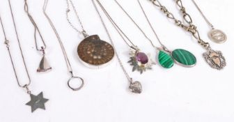 Nine silver pendants, to include silver and malachite example, heart shaped locket and various