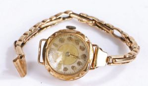 9 carat gold ladies wristwatch, the gilt and white dial with Arabic numerals, manual wound, the case