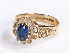 9 carat gold ring set with blue and clear paste, ring size L, 2.1g