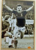 John Wark, signed black and white photograph, with COA from Sportizus, housed within a gilt and