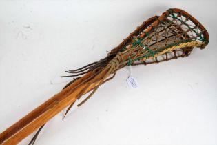 Two wooden lacrosse sticks, one stamped 'Hattersley, Viktoria; (2)