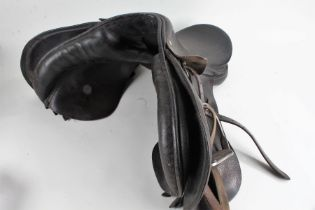 Black leather horse riding saddle, with a pair of stirrups