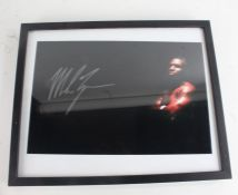 Mike Tyson, signed colour photograph, with COA and image of him signing, housed within a black and