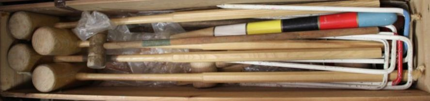 Croquet set, to include mallets and hoops, housed in a pine box