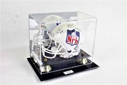 Miniature NFL helmet, signed by Phillip Rivers, Tony Romo, Brett Favre, Tom Brady, Eli Manning,