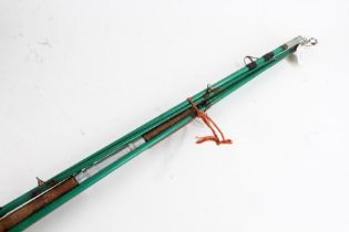 Metal four piece fishing rod, painted in green