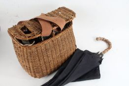 Wicker fishing basket and contents of seven various fishing reels to include Ambidex casting reel,
