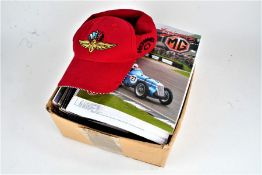 Collection of motor racing programmes, Indianapolis Motor Speedway baseball cap and a large film