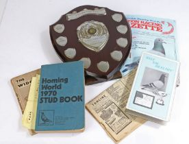 Racing pigeon related ephemera, to include trophy, stud book, VHS video etc.