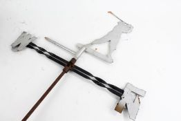 20th Century weather vane, the rotating finial in the form a golfer mid-swing, 81cm high, 62cm wide