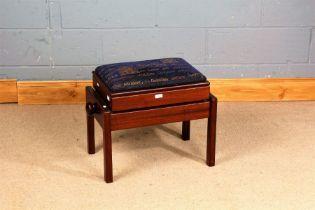 Edwardian style mahogany piano stool, the hinged adjustable seat raised on square legs,
