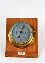 "Sestrel brass cased marine barometer, the silvered dial inscribed ""CAP'T O.M. WATTS LTD. LONDON"", on"