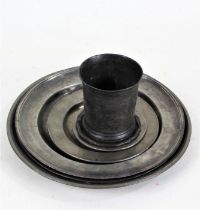 Pewter to include armorial dish, five plates and small dishes, beaker (7)