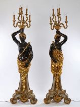 Pair of Venetian style Blackamoor candelabras, the standing male and female figures holding aloft