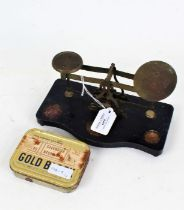Set of N.B. Paris postal scales, on a serpentine plinth base, together with seven weights from 4oz -