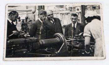 20th Century black and white postcard, depicting King George VI at a factory, circa 1941, 13.5cm