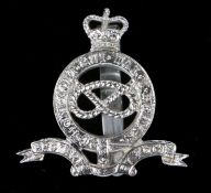 Scarce cap badge in anodised aluminium to The Staffordshire Yeomanry (Queens Own Royal Regiment),