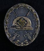 Second World War German Wound Badge in black, tombac construction with intact pin fitting to the