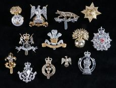 Selection of British army cap badges in anodised aluminium to include, The Border Regiment, slider