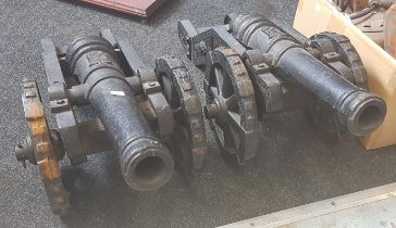 PAIR OF ANTIQUE CAST IRON CANNONS