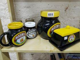 Shelf lot of old Marmite jars