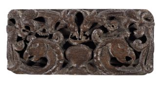 A mid-to late 16th century carved oak panel, English, circa 1550-1600
