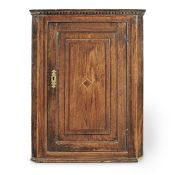 A George III joined oak and fruitwood inlaid mural corner cupboard, circa 1790