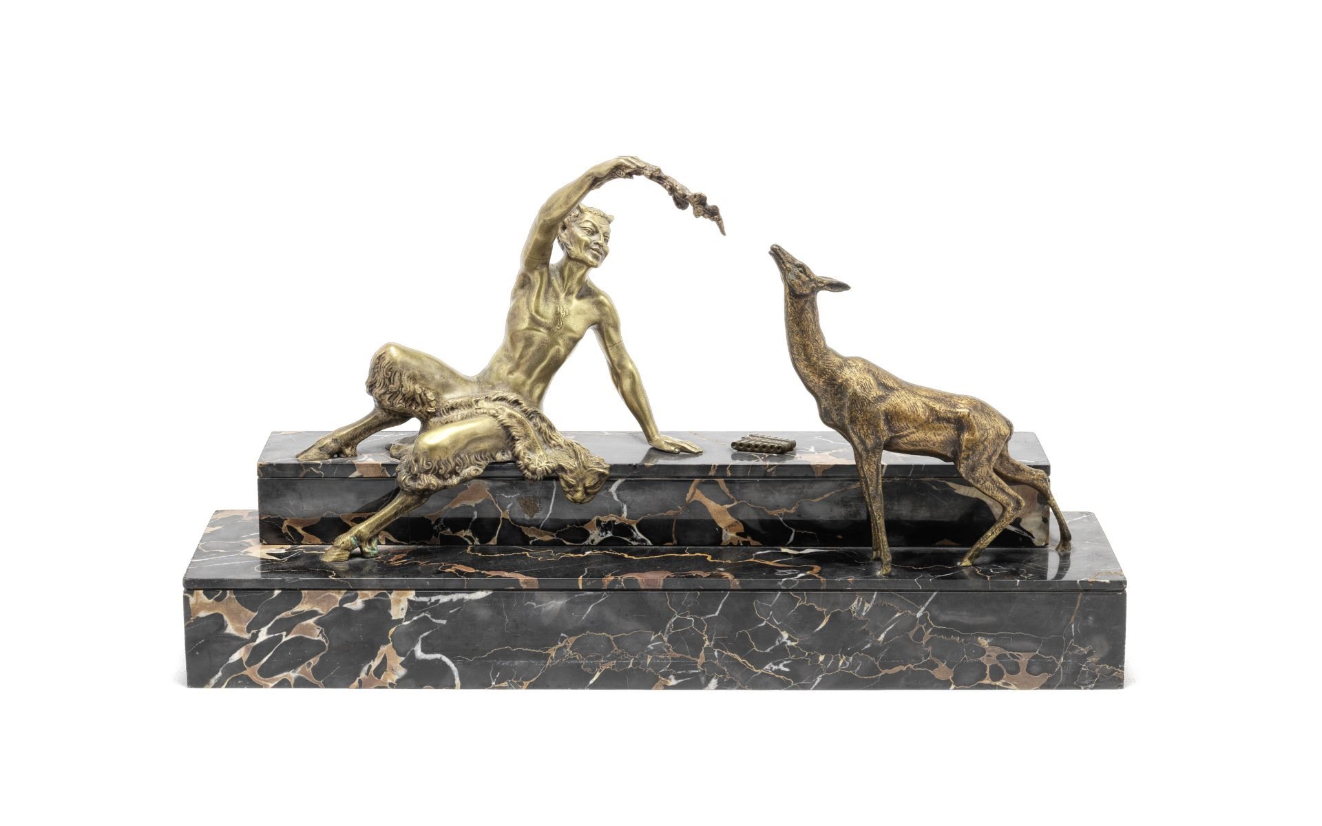 Marcel Andre Bouraine (French, 1886-1948): A gilt and shaded bronze model of a satyr and faun ci...