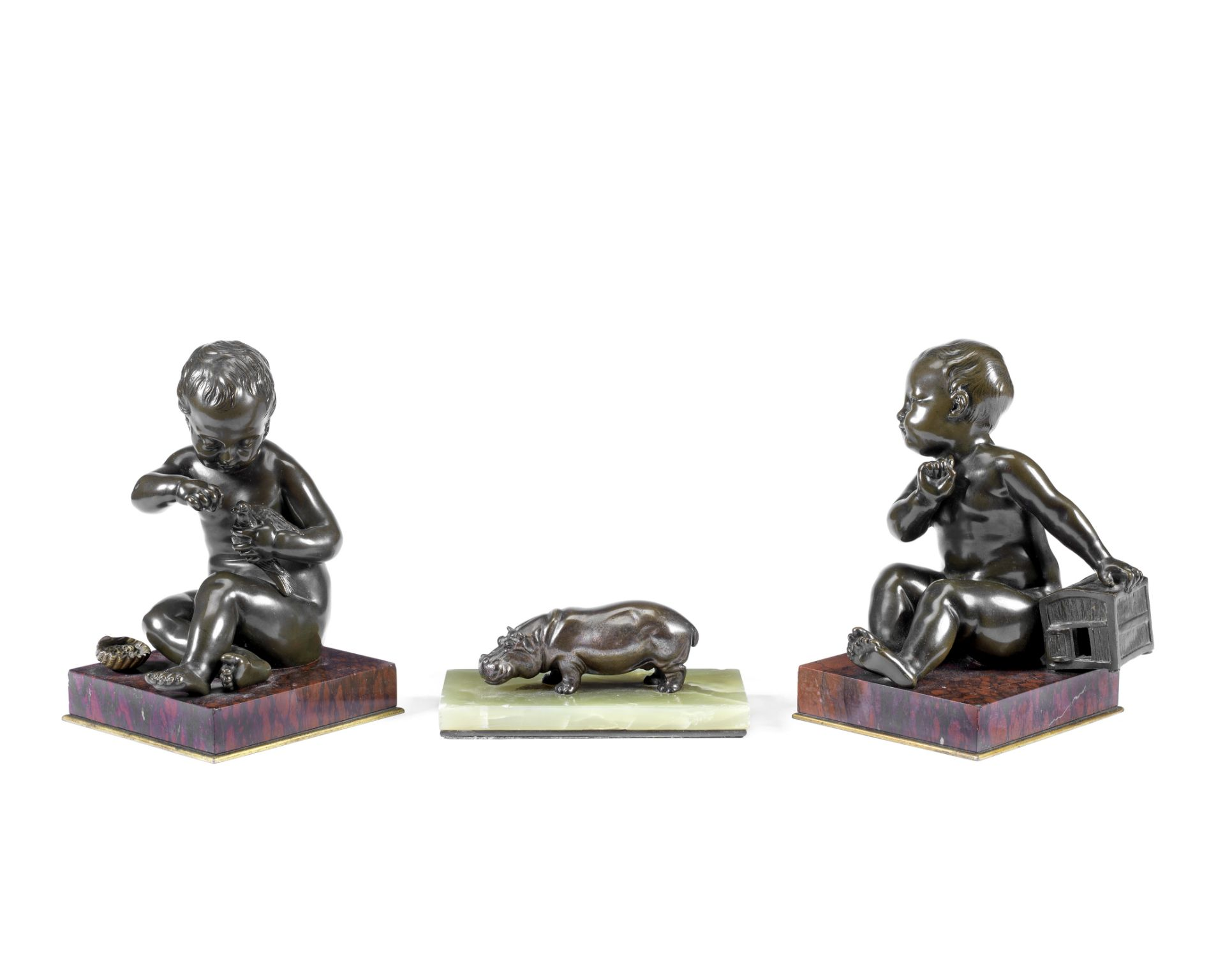 After Jean-Baptiste Pigalle (French, 1714-85): A pair of late 19th century patinated bronze figur...