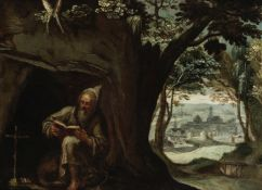 Flemish School, 17th Century A hermit seated before a cave, a landscape beyond