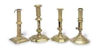 Four 18th century brass ejector candlesticks, English (4)