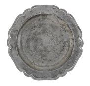 An unusual George II pewter six lobed wavy-edge plate, circa 1745