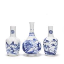 A BLUE AND WHITE 'KYLIN' BOTTLE VASE AND A RELATED PAIR OF VASES Kangxi and 18th/19th century