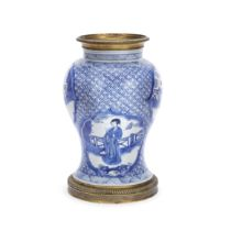 A GILT METAL-MOUNTED BLUE AND WHITE BALUSTER VASE The porcelain Kangxi