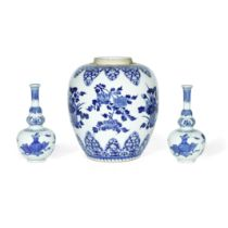 A BLUE AND WHITE FLORAL JAR AND A PAIR OF TRIPLE GOURD VASES Kangxi (3)
