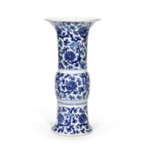 A BLUE AND WHITE 'LOTUS' BEAKER VASE, GU Late Qing Dynasty