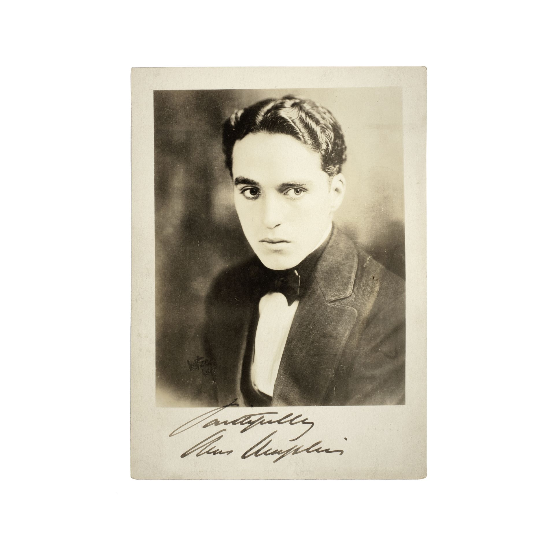 Charles Chaplin: An early signed publicity photograph, circa 1917,