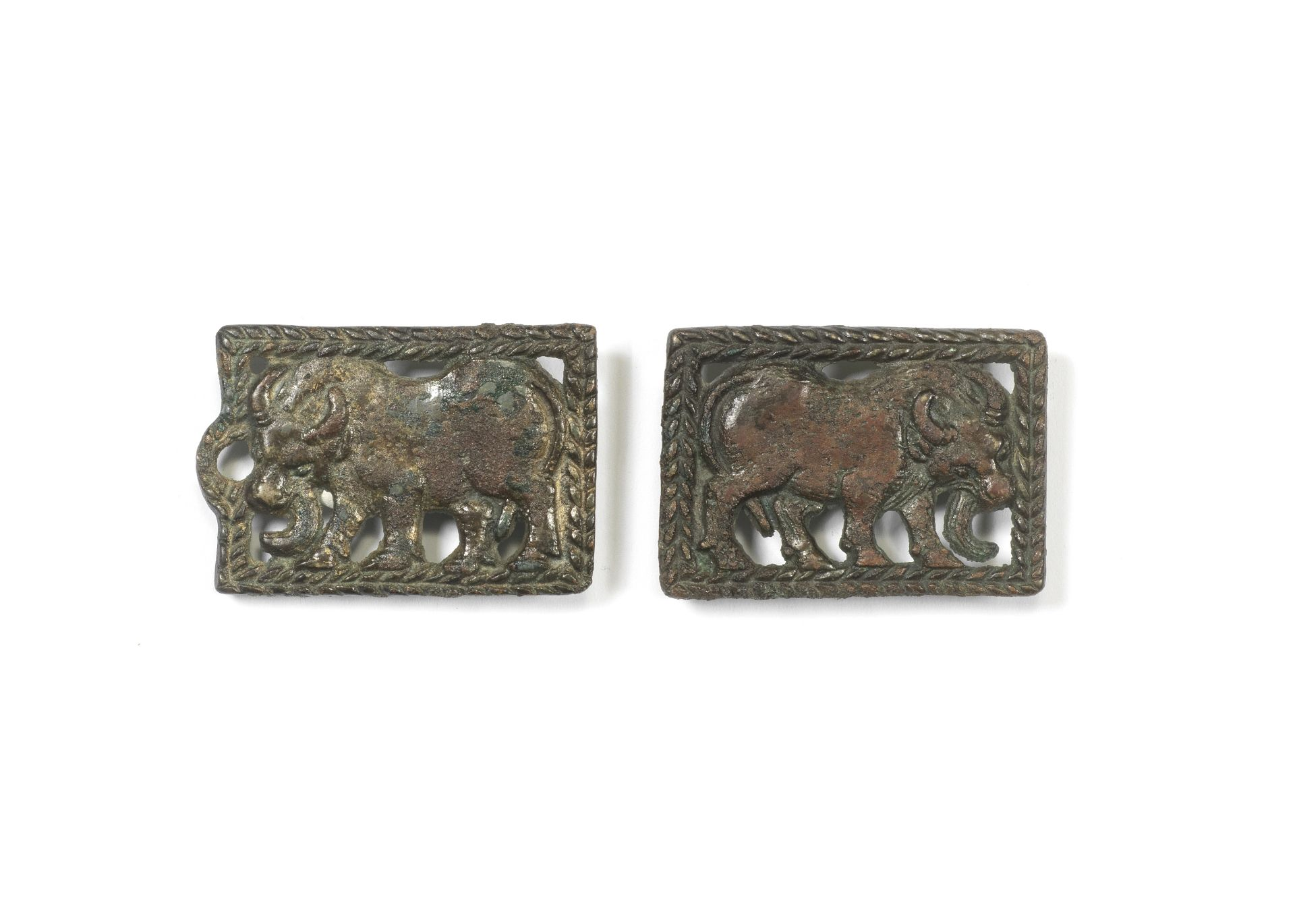 A PAIR OF ORDOS BRONZE 'WATER BUFFALO' BELT PLAQUES 4th/3rd century BC (2)