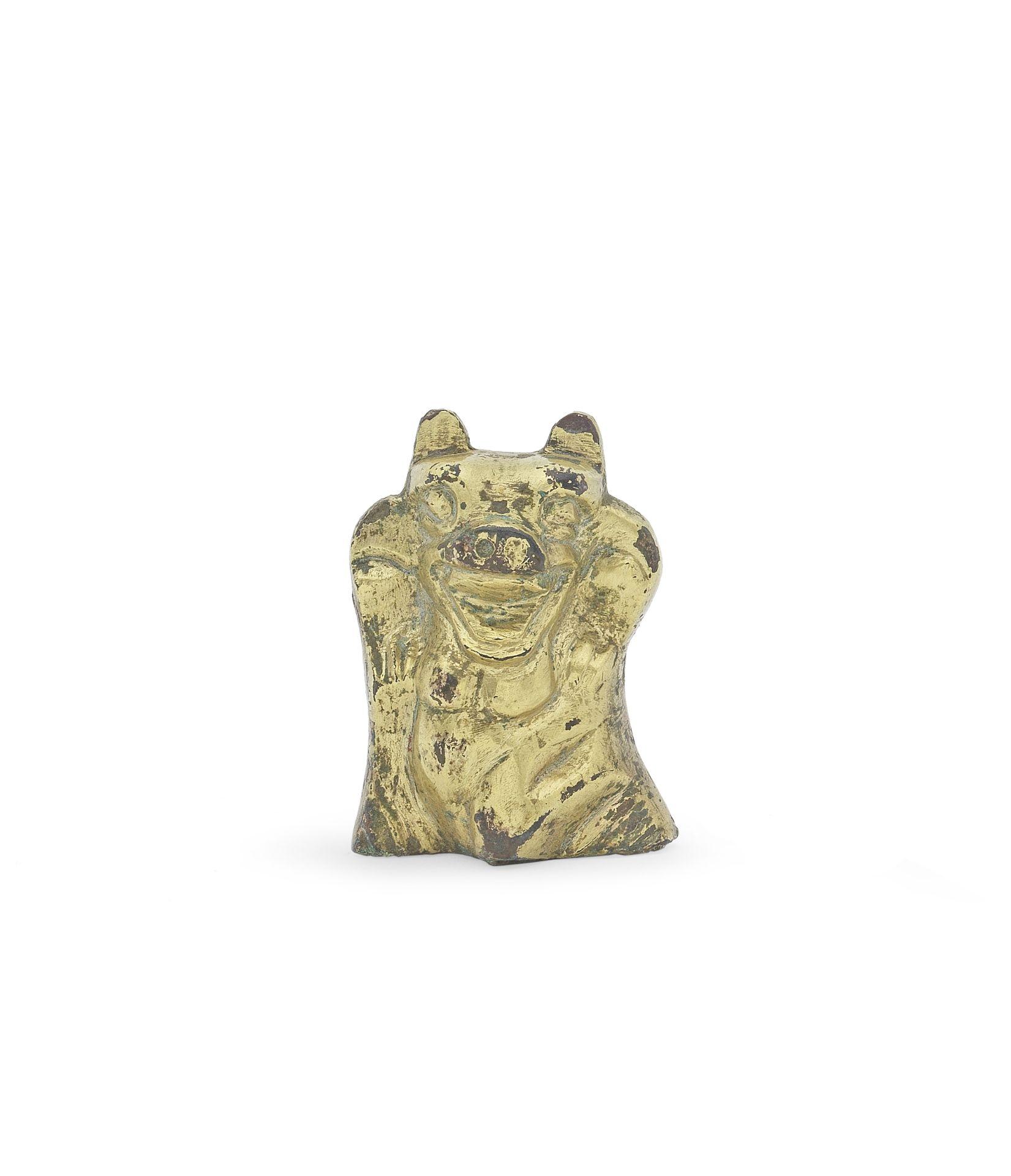 A RARE GILT-BRONZE BEAR-SHAPED SUPPORT Han Dynasty