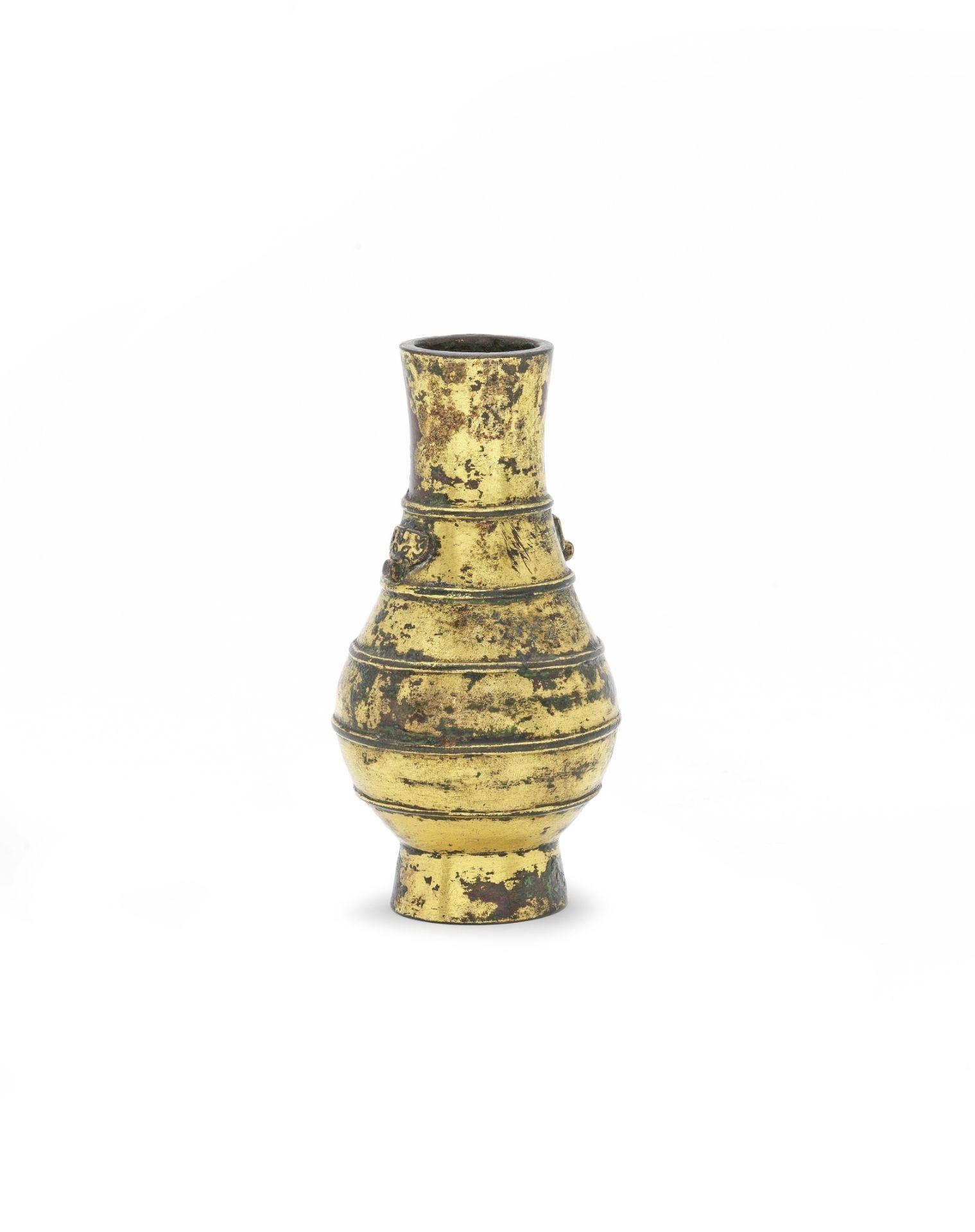 A RARE SMALL GILT-BRONZE VASE, HU Ming Dynasty or earlier