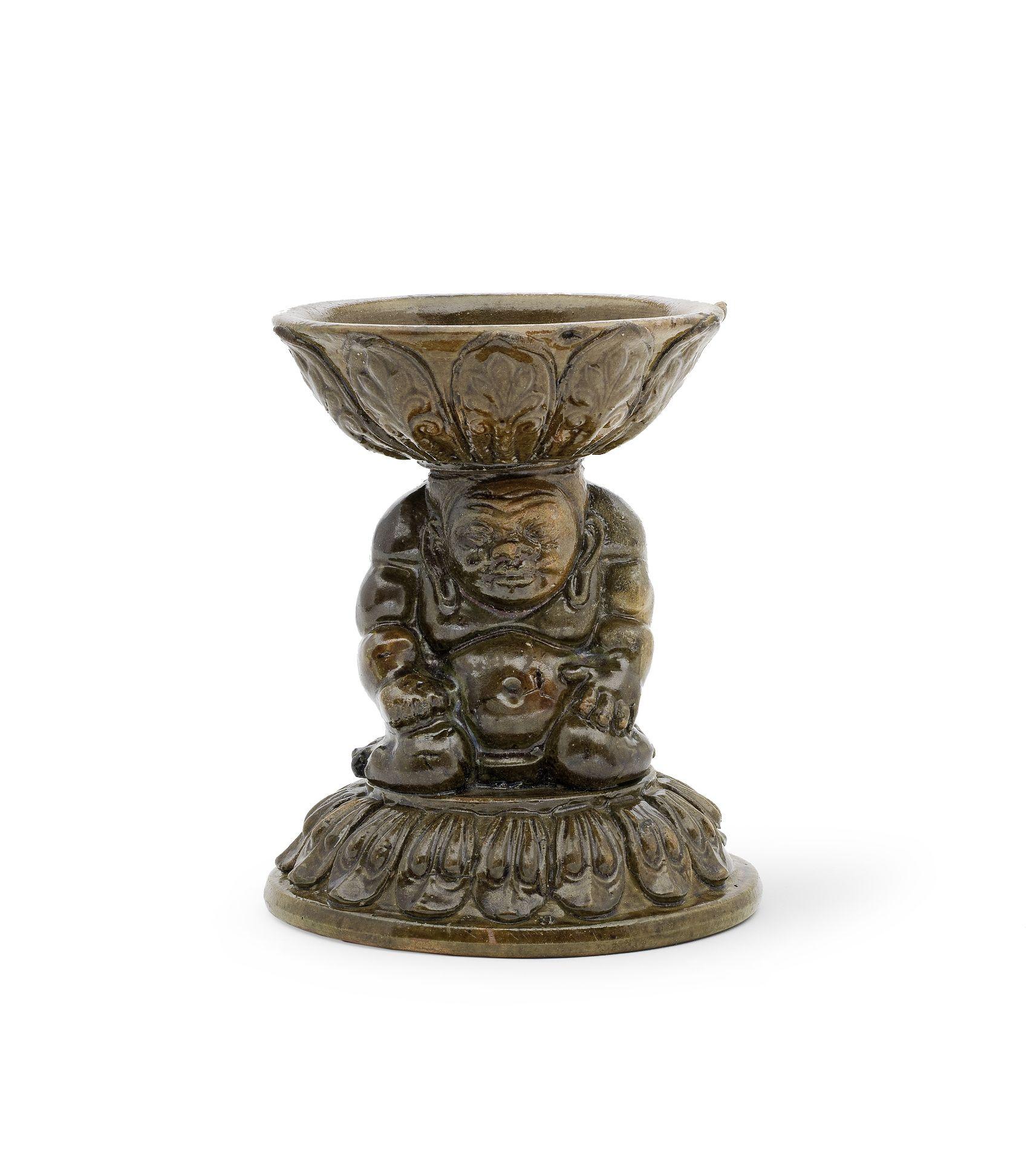 A RARE GREEN-GLAZED 'YAKSHA' LAMP Northern Qi Dynasty (2)