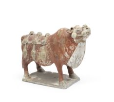A PAINTED POTTERY MODEL OF AN OX Tang Dynasty