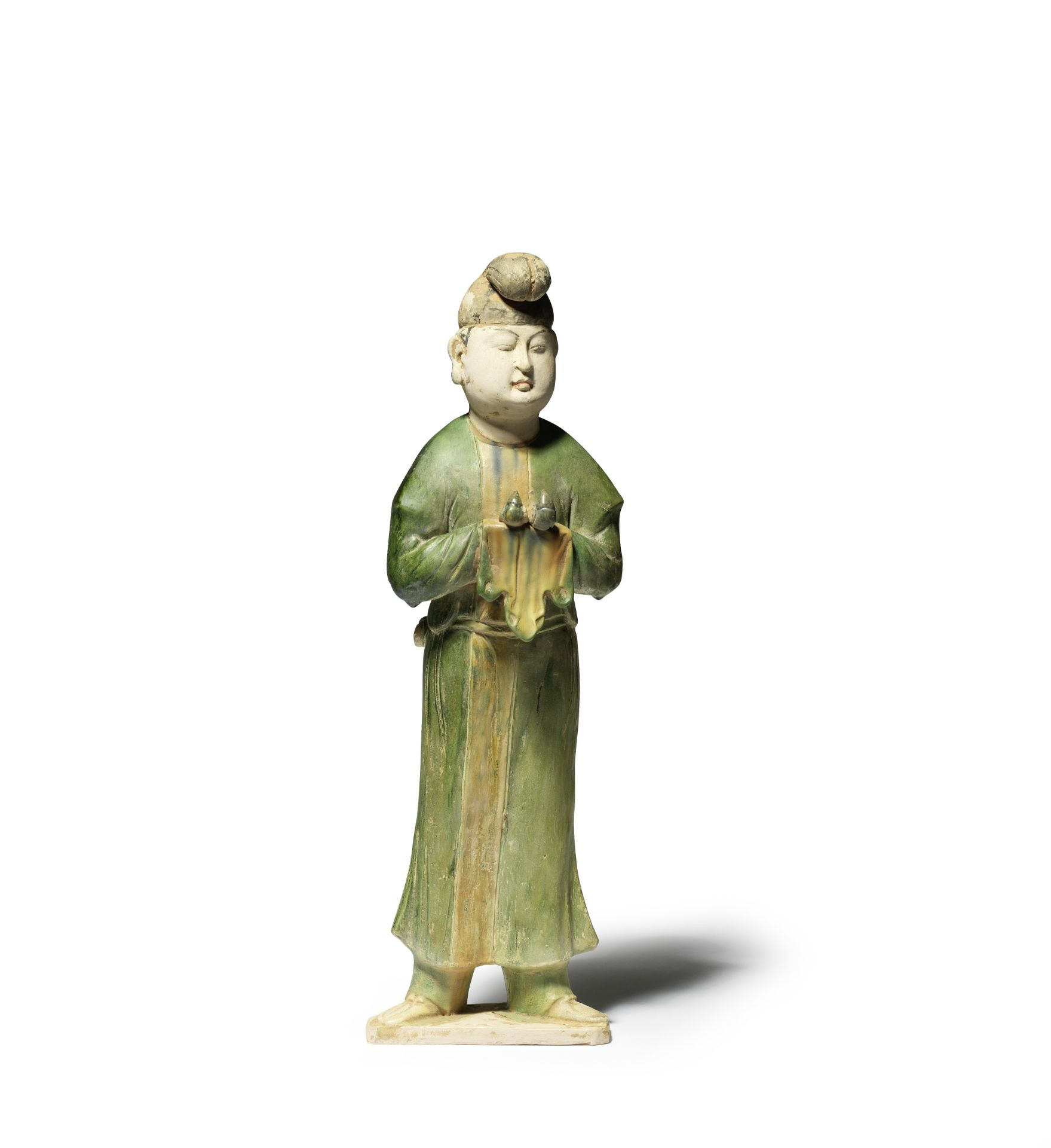 A RARE AND LARGE SANCAI-GLAZED POTTERY FIGURE OF A MALE ATTENDANT Tang Dynasty